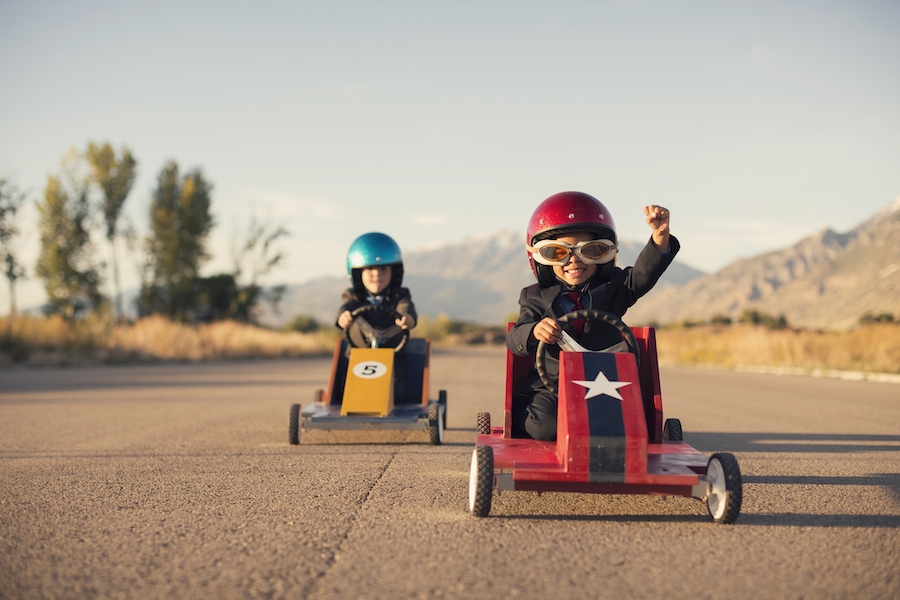 two kids racing down the road - home care marketing solutions
